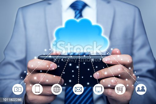 istock Businessman using mobile phone and information communication technology concept 1011802286