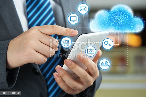 istock Businessman using mobile phone and information communication technology concept 1011810128