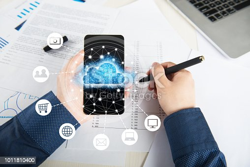 istock Businessman using mobile phone and information communication technology concept 1011810400