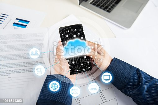 istock Businessman using mobile phone and information communication technology concept 1011814360