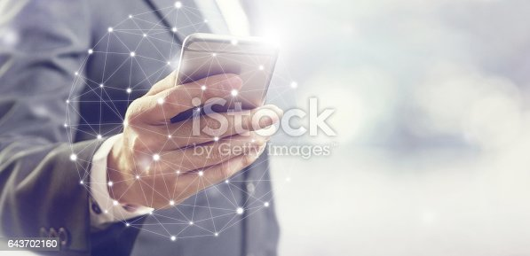 istock Businessman using mobile phone communication network 643702160