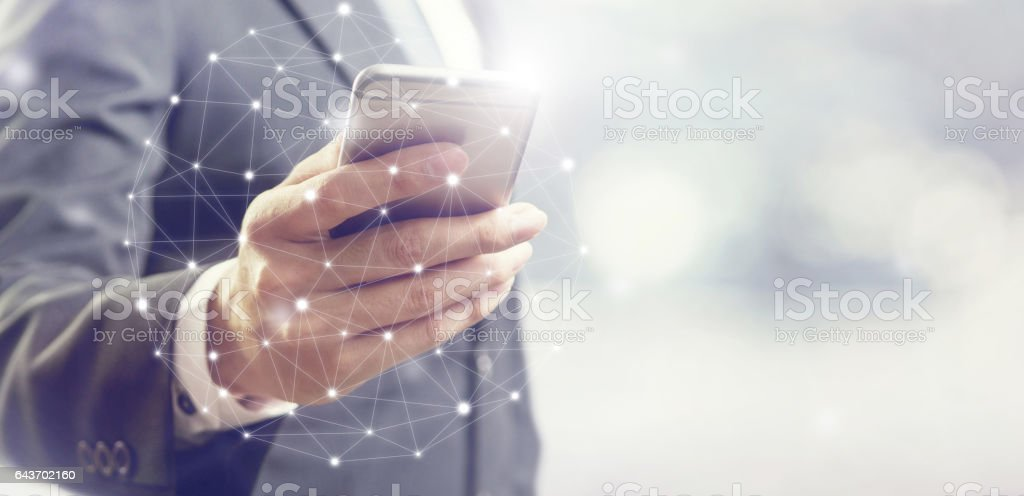 Businessman using mobile phone communication network stock photo