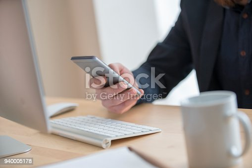 istock Businessman using mobile phone communication network 940005178