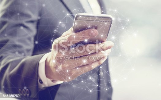 istock Businessman using mobile phone 648489262