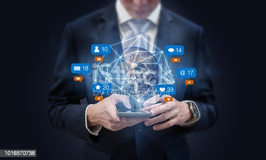 istock Businessman using mobile smart phone, and augmented reality with social media, network notification icons. Element of this image are furnished by NASA 1016570738