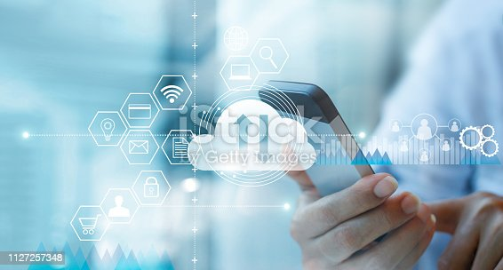 istock Businessman using mobile smartphone and connecting cloud computing service with icon customer network connection. Cloud device online storage. Cloud technology internet networking concept. 1127257348