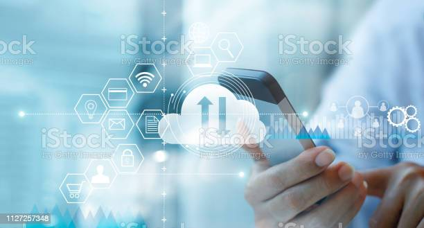 Businessman using mobile smartphone and connecting cloud computing picture id1127257348?b=1&k=6&m=1127257348&s=612x612&h=0uw0idfdcl te4vy12gxahiuqe0w5xevhow2agepxvm=