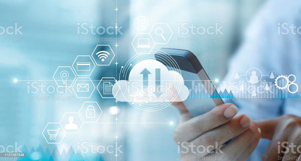 Businessman using mobile smartphone and connecting cloud computing service with icon customer network connection. Cloud device online storage. Cloud technology internet networking concept. stock photo