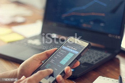 Businessman using mobile smartphone with data information banking network connection on screen, mobile banking and online payment. All on screen are design up.