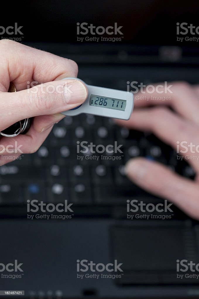 Businessman using secure identification number to access corporate data royalty-free stock photo