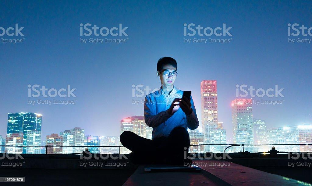Businessman using smart phone stock photo