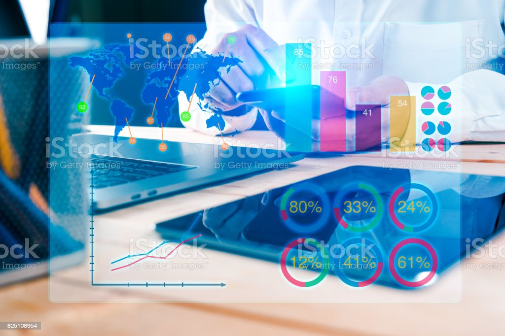 Businessman using smart phone to view HUD Financial Graph Dashboard stock photo