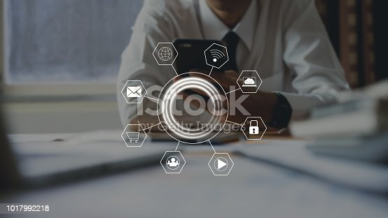 istock businessman using smartphone and show sign technology icon. Concept of future and trend internet for easy access to information. 1017992218