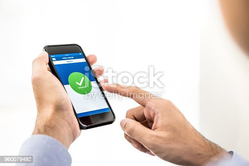 istock Businessman using smartphone application transferring money online 960079492