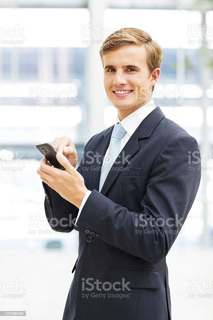 Businessman Using Smartphone royalty-free stock photo