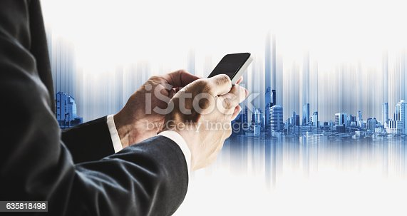 635942136istockphoto Businessman using smartphone with city, business communication technology concepts 635818498