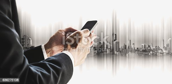 635942136istockphoto Businessman using smartphone with city, business communication technology concepts 636275108