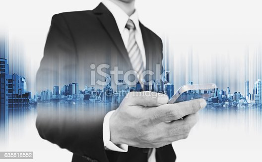 635942136istockphoto Businessman using smartphone, with double exposure city, business communication technology 635818552