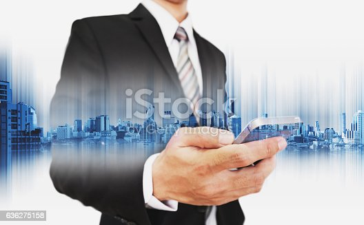 635942136istockphoto Businessman using smartphone, with double exposure city, business communication technology 636275158