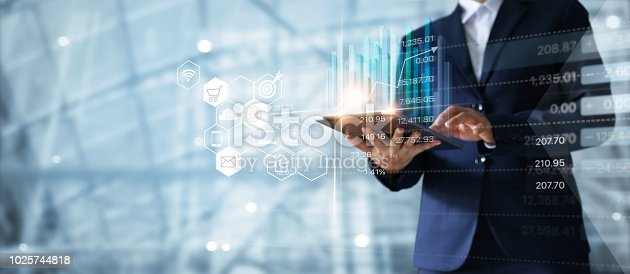 1127866562 istock photo Businessman using tablet analyzing sales data and economic growth graph chart. Business strategy. Abstract icon. Digital marketing. 1025744818