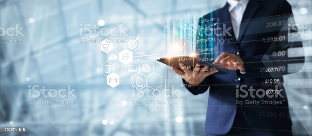 Businessman using tablet analyzing sales data and economic growth graph chart. Business strategy. Abstract icon. Digital marketing. - foto stock