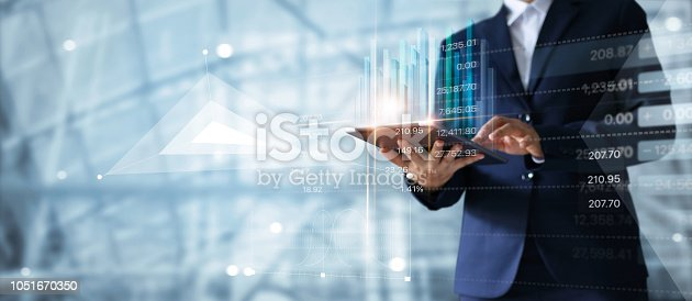 istock Businessman using tablet analyzing sales data and economic growth graph chart. Business strategy. Abstract icon. Digital marketing. 1051670350