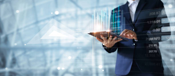Businessman using tablet analyzing sales data and economic growth graph chart. Business strategy. Abstract icon. Digital marketing. stock photo