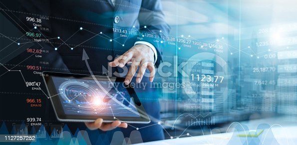 Businessman using tablet analyzing sales data and economic growth graph chart. Business strategy. Abstract icon. Stock market. Digital marketing.