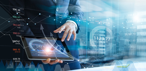 1025744818 istock photo Businessman using tablet analyzing sales data and economic growth graph chart. Report. Business strategy. Abstract icon. Stock market. Digital marketing. 1150196823
