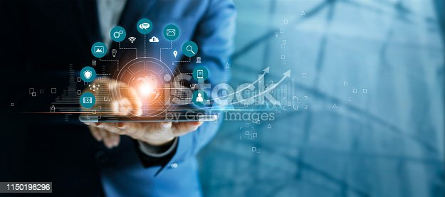 istock Businessman using tablet analyzing sales data and economic growth graph chart, Technology and icon customer global network connection. Business strategy. Innovative. Digital marketing. 1150198296