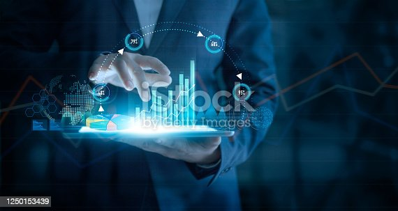 1127866562 istock photo Businessman using tablet analyzing sales data and economic growth graph chart on virtual interface. Business strategy. Abstract icon. Digital marketing. 1250153439