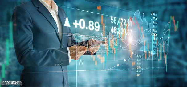 1051659174 istock photo Businessman using tablet and analyzing sales data economic growth graph on modern virtual interface, Business strategy and planning, stock market and exchange on network. 1250153411