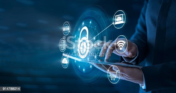 Businessman using tablet and set up network connection with shield guard to protected from cyber attacks. Network security system concept