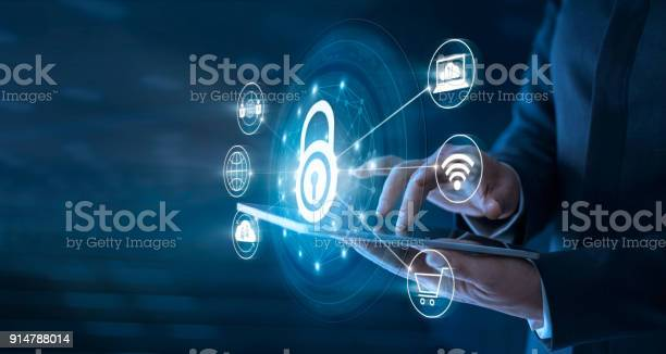 Businessman using tablet and set up network connection with shield picture id914788014?b=1&k=6&m=914788014&s=612x612&h=gthssv4iywrhjbgipty01ljtqxlt nlqov8rtilcvnk=