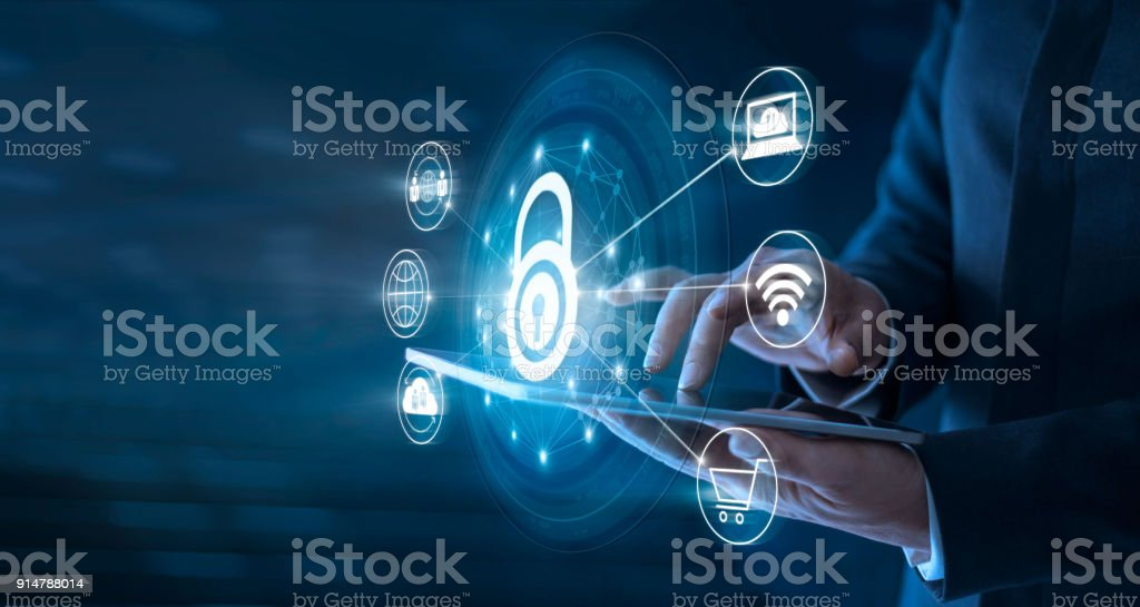 Businessman using tablet and set up network connection with shield guard to protected from cyber attacks. Network security system concept stock photo