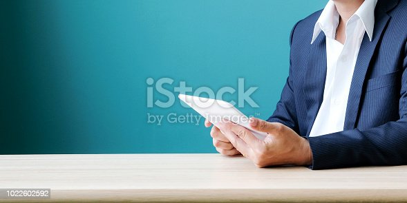 istock Businessman using tablet at desk office background with copy space, casual office life concept, banner 1022602592