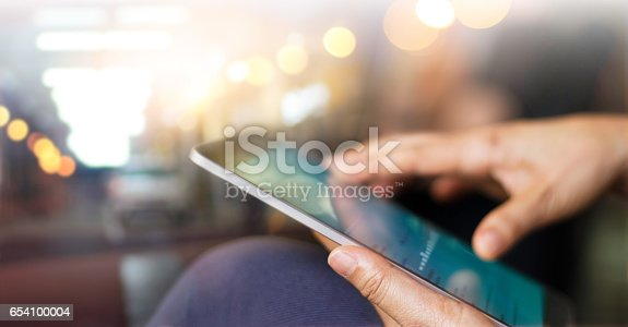 istock Businessman using tablet at night time 654100004