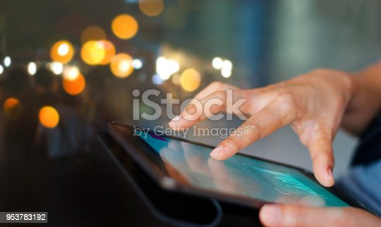 istock Businessman using tablet at night time 953783192