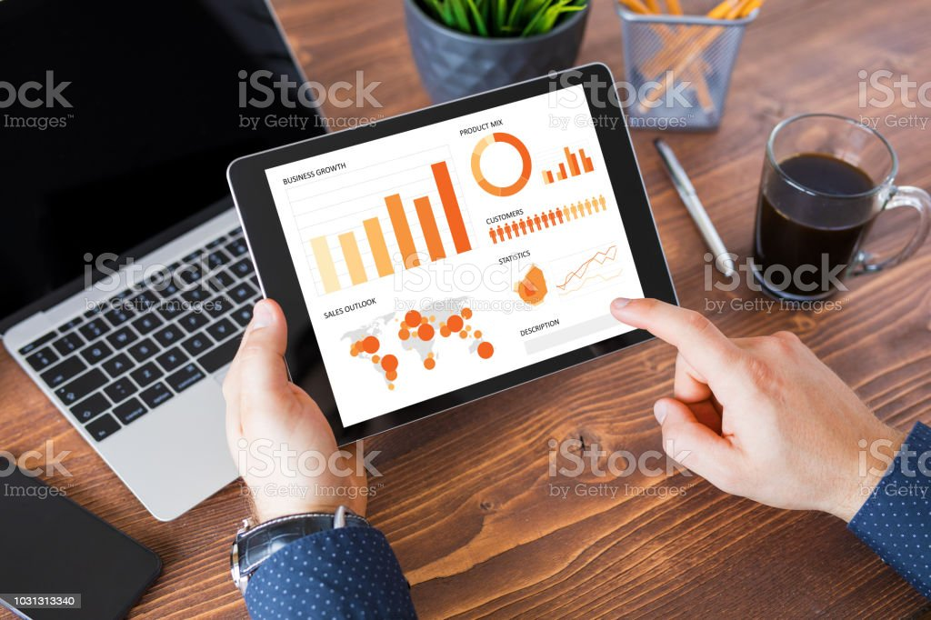 Businessman using tablet computer at work. stock photo