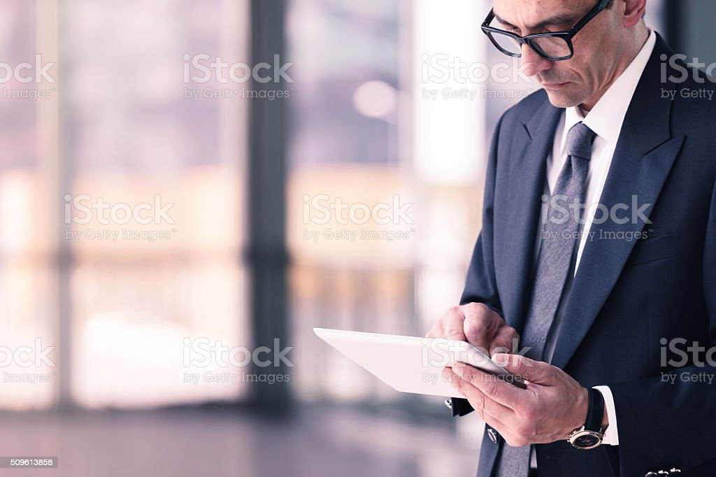 businessman using tablet computer in office stock photo