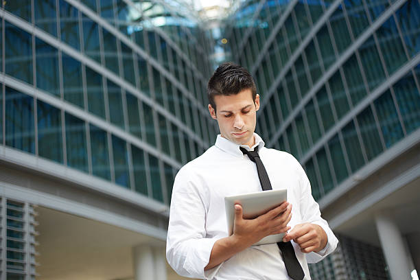 businessman using tablet computer stock photo