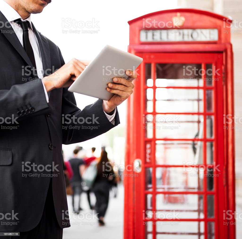 Businessman using tablet In London royalty-free stock photo
