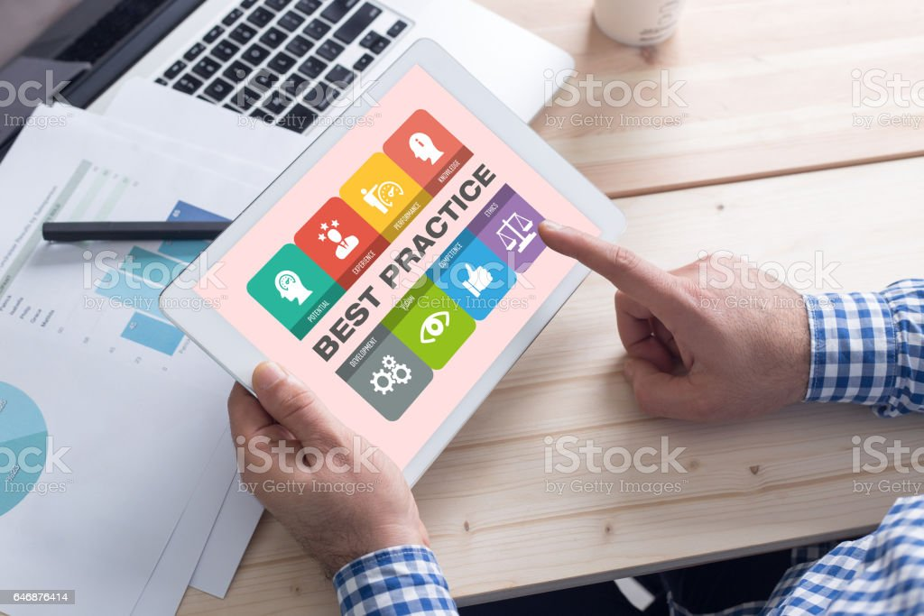 Businessman using tablet pc and Best Practice concept on screen stock photo