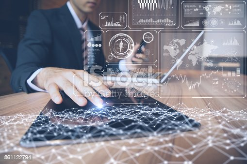 istock businessman using tablet PC and information communication technology concept. IoT(Internet of Things). GUI(graphical user interface). paperless office. 861122794