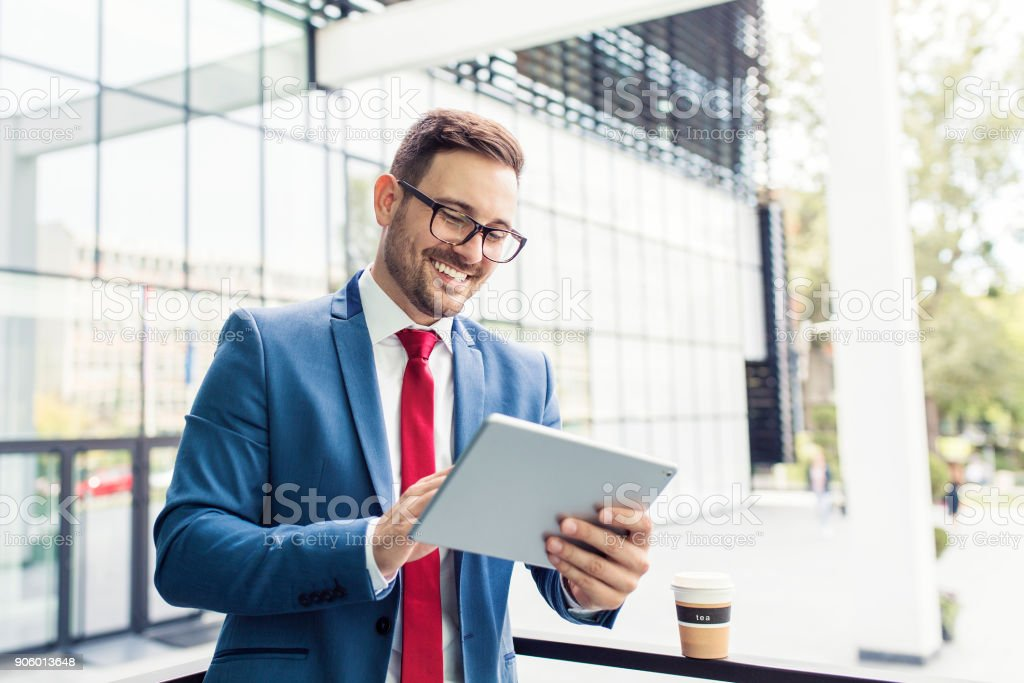 Businessman using tablet stock photo