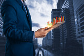 istock Businessman using tablet with finance and banking profit graph of stock market trade indicator financial 1174825564
