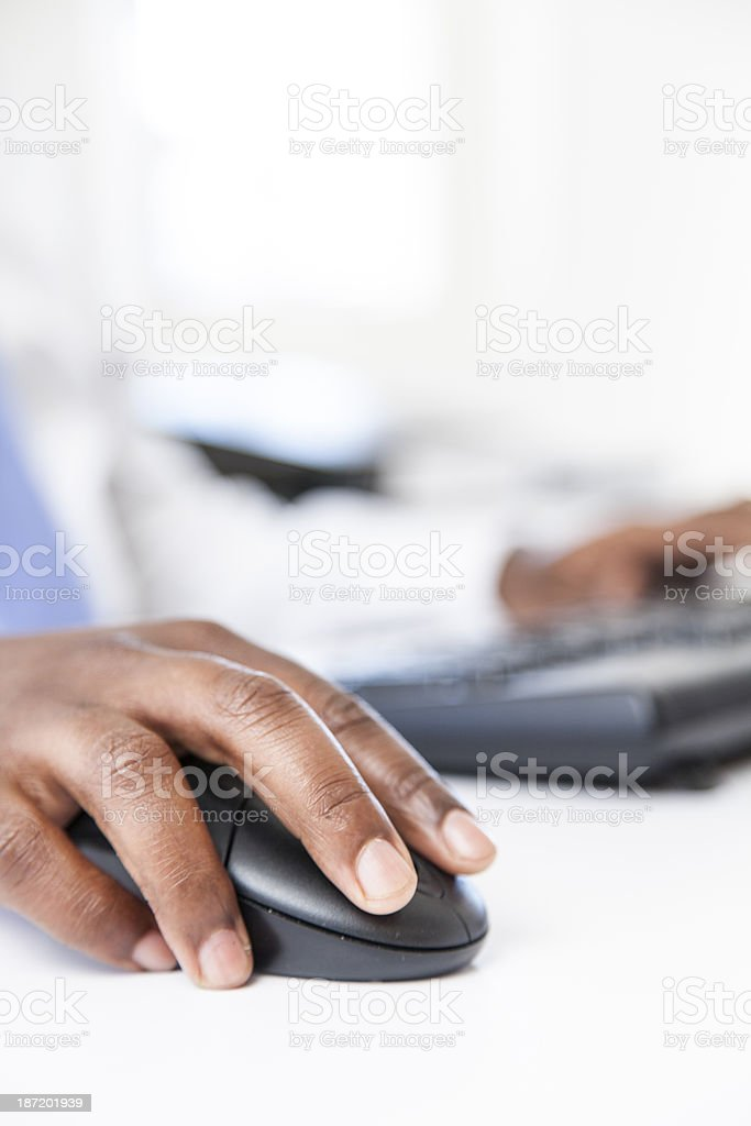 Businessman using the computer mouse royalty-free stock photo