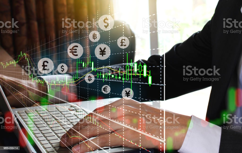 businessman using the laptop and stock market or forex graph royalty-free stock photo