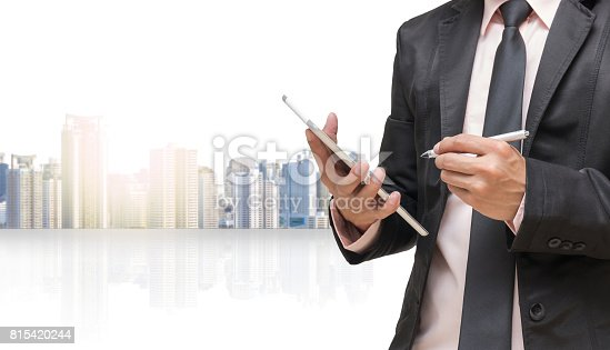 istock Businessman using the tablet on cityscape blurred background,Business concept 815420244