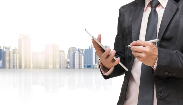 businessman using the tablet on cityscape blurred background,business concept - petticoat stock pictures, royalty-free photos & images